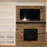 basement-fireplace-white-shelves-tv