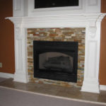 fireplace-colored-stone-white-mantel