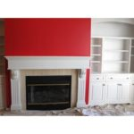 white-cabinets-red-wall-fireplace