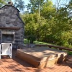 exterior-neighbor-fireplace-hottub
