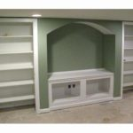 shelving-against-green-wall