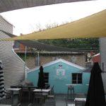 closed-umbrellas-blue-house