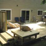 wooden-porch-green-umbrella