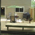 wooden-porch-green-umbrella-front-view